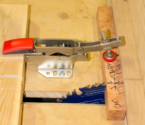 The Bessey clamp holding the now-cut pen blank in place.